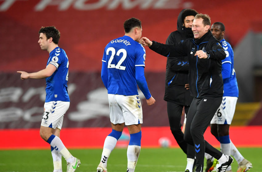 LIVERPOOL, ENGLAND - FEBRUARY 20: Ben Godfrey of Everton and Duncan Ferguson, Assistant Manager of Everton celebrate following their team's victory in the Premier League match between Liverpool and Everton at Anfield on February 20, 2021 in Liverpool, England. Sporting stadiums around the UK remain under strict restrictions due to the Coronavirus Pandemic as Government social distancing laws prohibit fans inside venues resulting in games being played behind closed doors. (Photo by Paul Ellis - Pool/Getty Images)