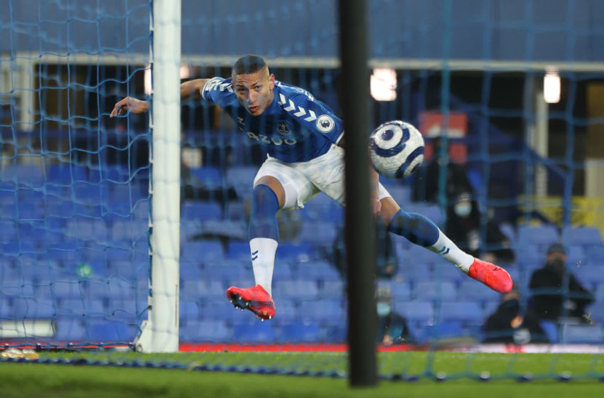 LIVERPOOL, ENGLAND - MARCH 01: Richarlison of Everton scores their team's first goal during the Premier League match between Everton and Southampton at Goodison Park on March 01, 2021 in Liverpool, England. Sporting stadiums around the UK remain under strict restrictions due to the Coronavirus Pandemic as Government social distancing laws prohibit fans inside venues resulting in games being played behind closed doors. (Photo by Clive Brunskill/Getty Images)
