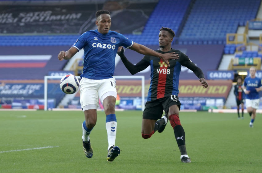 LIVERPOOL, ENGLAND - APRIL 05: Yerry Mina of Everton battles for possession with Wilfried Zaha of Crystal Palace during the Premier League match between Everton and Crystal Palace at Goodison Park on April 05, 2021 in Liverpool, England. Sporting stadiums around the UK remain under strict restrictions due to the Coronavirus Pandemic as Government social distancing laws prohibit fans inside venues resulting in games being played behind closed doors. (Photo by Jon Super - Pool/Getty Images)