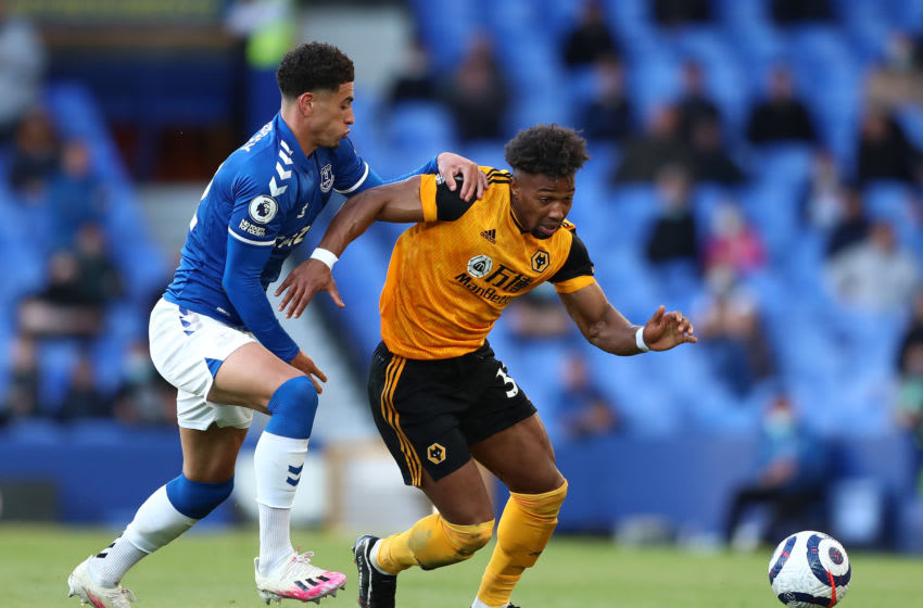 LIVERPOOL, ENGLAND - MAY 19: Adama Traore of Wolverhampton Wanderers battles for possession with Ben Godfrey of Everton during the Premier League match between Everton and Wolverhampton Wanderers at Goodison Park on May 19, 2021 in Liverpool, England. A limited number of fans will be allowed into Premier League stadiums as Coronavirus restrictions begin to ease in the UK. (Photo by Jan Kruger/Getty Images)