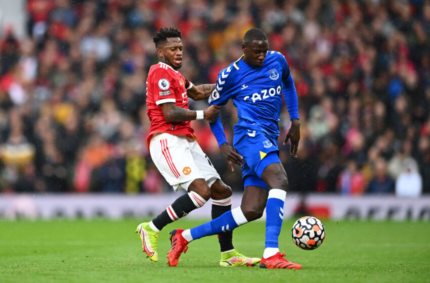 MANCHESTER, ENGLAND - OCTOBER 02: Abdoulaye Doucoure of Everton holds off Fred of Manchester United during the Premier League match between Manchester United and Everton at Old Trafford on October 02, 2021 in Manchester, England. (Photo by Clive Mason/Getty Images)