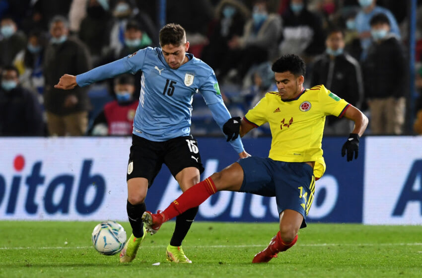 MONTEVIDEO, URUGUAY - OCTOBER 07: Federico Valverde of Uruguay fights for the ball with Luis Diaz of Colombia during a match between Uruguay and Colombia as part of South American Qualifiers for Qatar 2022 at Parque Central Stadium on October 07, 2021 in Montevideo, Uruguay. (Photo by Pablo Porciuncula-Pool/Getty Images)