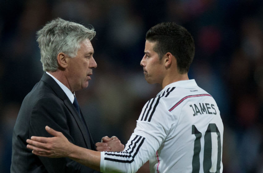 MADRID, SPAIN - APRIL 18: Head coach Carlo Ancelotti (L) of Real Madrid CF shakes hands with his player James Rodriguez (R) after the La Liga match between Real Madrid CF and Malaga CF at Estadio Santiago Bernabeu on April 18, 2015 in Madrid, Spain. (Photo by Gonzalo Arroyo Moreno/Getty Images)