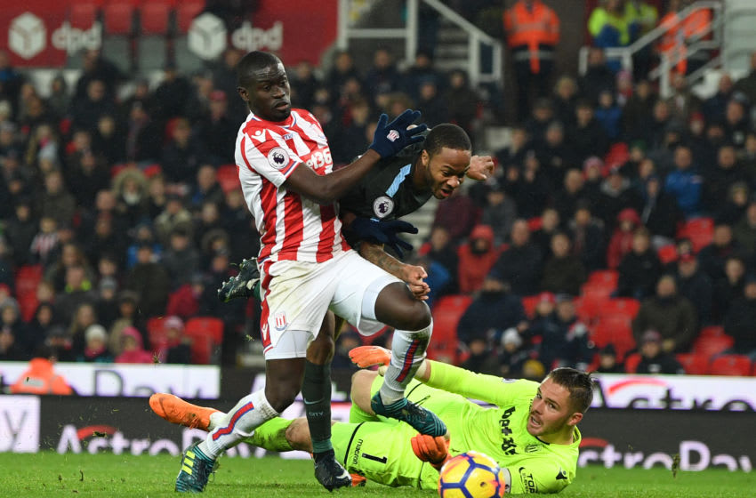 STOKE ON TRENT, ENGLAND - MARCH 12: Raheem Sterling of Manchester City is foiled by Badou Ndiaye and Jack Butland of Stoke City during the Premier League match between Stoke City and Manchester City at Bet365 Stadium on March 12, 2018 in Stoke on Trent, England. (Photo by Michael Regan/Getty Images)