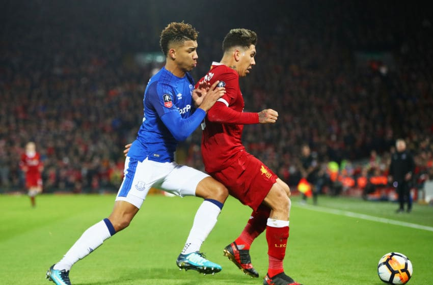 LIVERPOOL, ENGLAND - JANUARY 05: Roberto Firmino of Liverpool and Mason Holgate of Everton tussle for the ball during the Emirates FA Cup Third Round match between Liverpool and Everton at Anfield on January 5, 2018 in Liverpool, England. (Photo by Clive Brunskill/Getty Images)