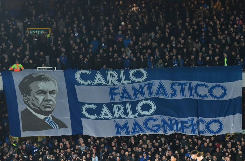 A banner honouring Everton's Italian head coach Carlo Ancelotti is unfurled during the English Premier League football match between Everton and Newcastle United at Goodison Park in Liverpool, north west England on January 21, 2020. (Photo by Paul ELLIS / AFP) / RESTRICTED TO EDITORIAL USE. No use with unauthorized audio, video, data, fixture lists, club/league logos or 'live' services. Online in-match use limited to 120 images. An additional 40 images may be used in extra time. No video emulation. Social media in-match use limited to 120 images. An additional 40 images may be used in extra time. No use in betting publications, games or single club/league/player publications. / (Photo by PAUL ELLIS/AFP via Getty Images)