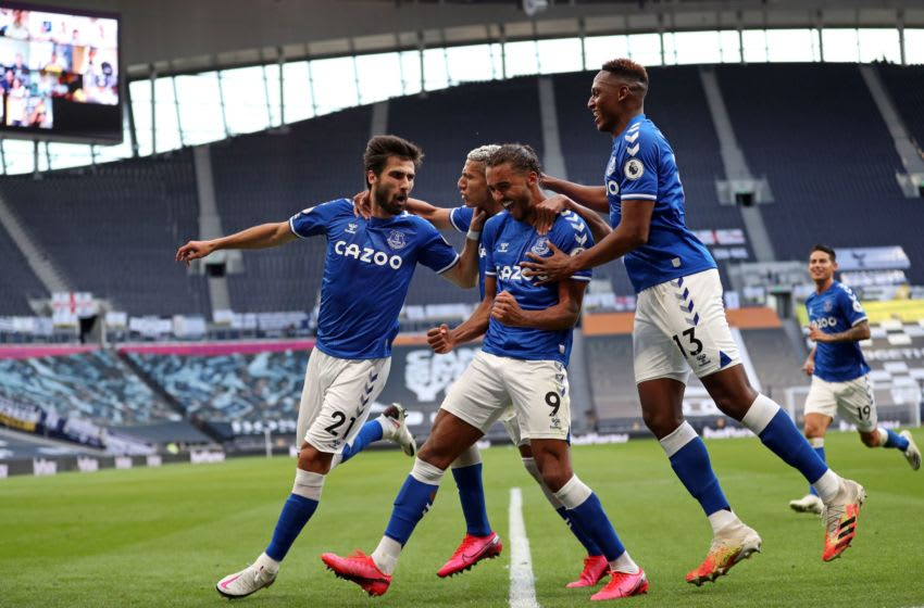 Everton's English striker Dominic Calvert-Lewin (C) celebrates with teammates after scoring Everton's first goal during the English Premier League football match between Tottenham Hotspur and Everton at Tottenham Hotspur Stadium in London, on September 13, 2020. (Photo by Catherine Ivill / POOL / AFP) / RESTRICTED TO EDITORIAL USE. No use with unauthorized audio, video, data, fixture lists, club/league logos or 'live' services. Online in-match use limited to 120 images. An additional 40 images may be used in extra time. No video emulation. Social media in-match use limited to 120 images. An additional 40 images may be used in extra time. No use in betting publications, games or single club/league/player publications. / (Photo by CATHERINE IVILL/POOL/AFP via Getty Images)