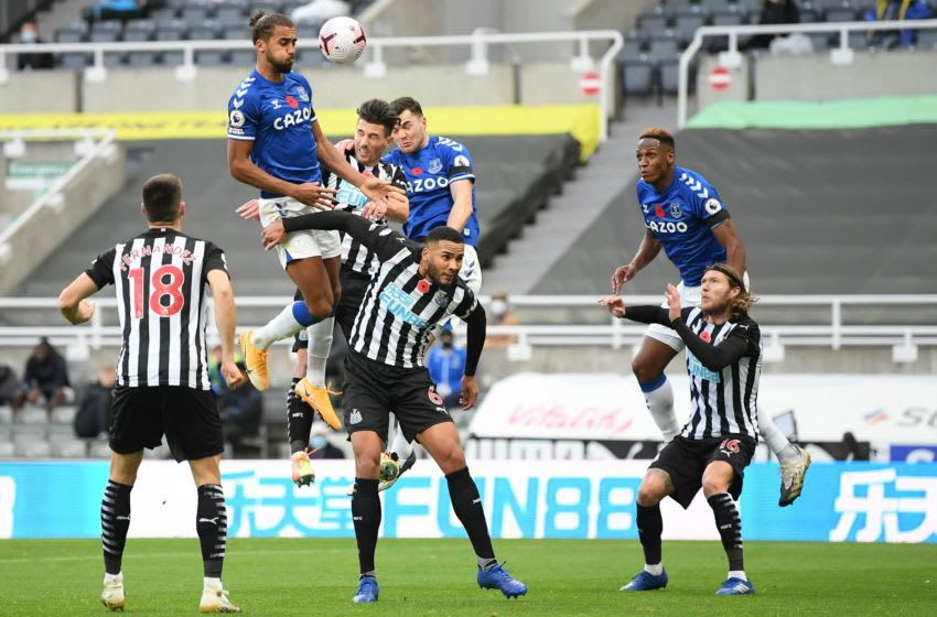 Everton's English striker Dominic Calvert-Lewin (2nd L) jumps to win a header during the English Premier League football match between Newcastle United and Everton at St James' Park in Newcastle-upon-Tyne, north east England on November 1, 2020. (Photo by Michael Regan / POOL / AFP) / RESTRICTED TO EDITORIAL USE. No use with unauthorized audio, video, data, fixture lists, club/league logos or 'live' services. Online in-match use limited to 120 images. An additional 40 images may be used in extra time. No video emulation. Social media in-match use limited to 120 images. An additional 40 images may be used in extra time. No use in betting publications, games or single club/league/player publications. / (Photo by MICHAEL REGAN/POOL/AFP via Getty Images)