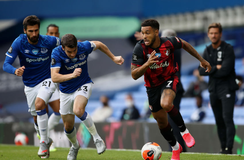 LIVERPOOL, ENGLAND - JULY 26: Joshua King of AFC Bournemouth runs with the ball under pressure from Seamus Coleman of Everton during the Premier League match between Everton FC and AFC Bournemouth at Goodison Park on July 26, 2020 in Liverpool, England. Football Stadiums around Europe remain empty due to the Coronavirus Pandemic as Government social distancing laws prohibit fans inside venues resulting in all fixtures being played behind closed doors. (Photo by Tim Goode/Pool via Getty Images)