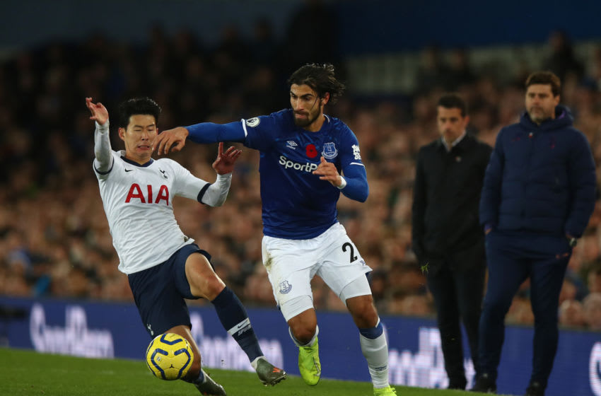 LIVERPOOL, ENGLAND - NOVEMBER 03: Son Heung-min of Tottenham Hotspur tackles Andre Gomes of Everton which resulted in a red card and Gomes suffering an injury during the Premier League match between Everton FC and Tottenham Hotspur at Goodison Park on November 3, 2019 in Liverpool, United Kingdom. (Photo by Robbie Jay Barratt - AMA/Getty Images)