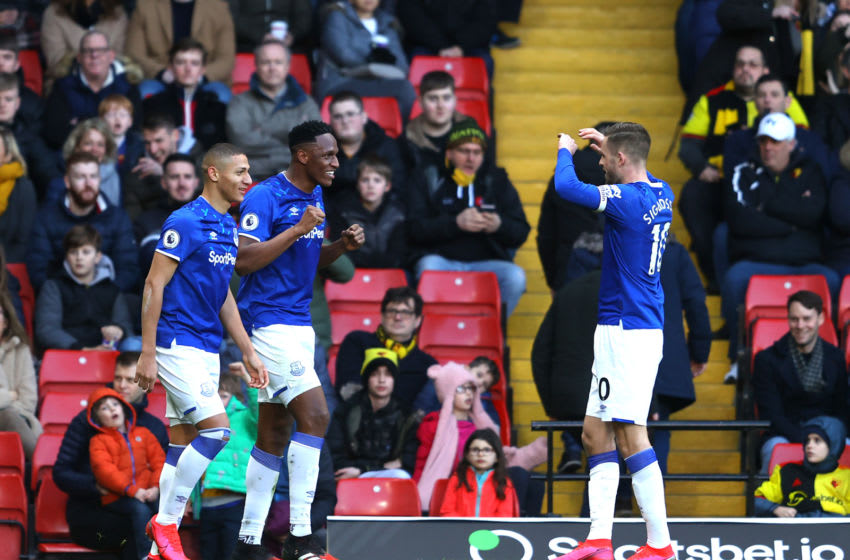 WATFORD, ENGLAND - FEBRUARY 01: Yerry Mina of Everton celebrates after scoring his team's first goal with Gylfi Sigurdsson and Richarlison during the Premier League match between Watford FC and Everton FC at Vicarage Road on February 01, 2020 in Watford, United Kingdom. (Photo by Richard Heathcote/Getty Images)