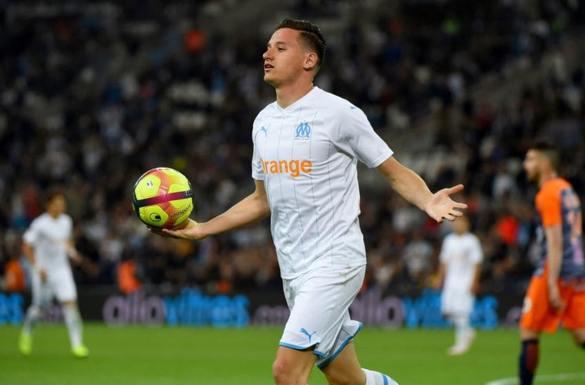 Marseille's French forward Florian Thauvin celebrates after scoring a goal during the French L1 football match between Marseille and Montpellier, on May 24, 2019 at the Orange Velodrome Stadium in Marseille, southern France. (Photo by SYLVAIN THOMAS / AFP) (Photo credit should read SYLVAIN THOMAS/AFP via Getty Images)