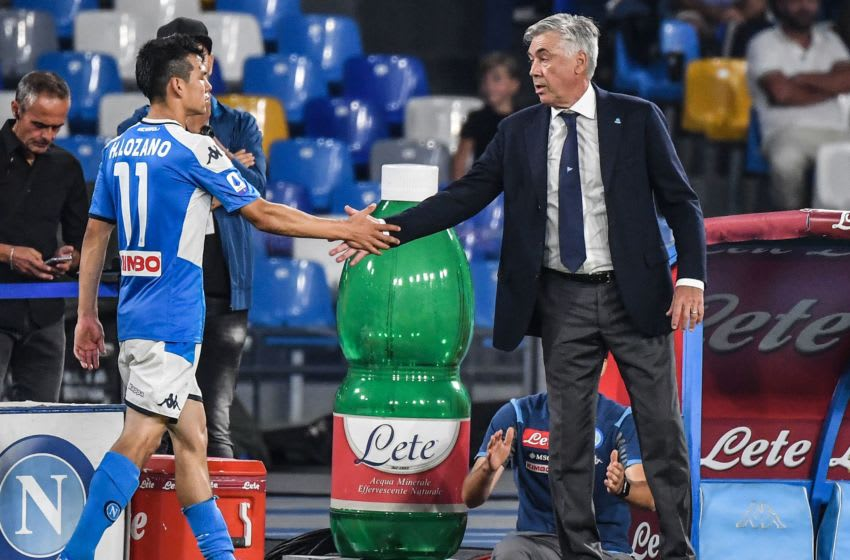 Napoli's Italian head coach Carlo Ancelotti (R) taps hand with Napoli's Mexican forward Hirving Lozano during the Italian Serie A football match Napoli vs Cagliari on September 25, 2019 at the San Paolo stadium in Naples. (Photo by Andreas SOLARO / AFP) (Photo credit should read ANDREAS SOLARO/AFP via Getty Images)