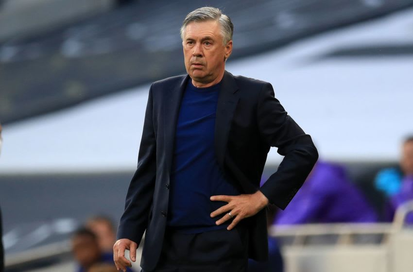 Everton's Italian head coach Carlo Ancelotti watches his players from the touchline during the English Premier League football match between Tottenham Hotspur and Everton at Tottenham Hotspur Stadium in London, on July 6, 2020. (Photo by Adam Davy / POOL / AFP) / RESTRICTED TO EDITORIAL USE. No use with unauthorized audio, video, data, fixture lists, club/league logos or 'live' services. Online in-match use limited to 120 images. An additional 40 images may be used in extra time. No video emulation. Social media in-match use limited to 120 images. An additional 40 images may be used in extra time. No use in betting publications, games or single club/league/player publications. / (Photo by ADAM DAVY/POOL/AFP via Getty Images)