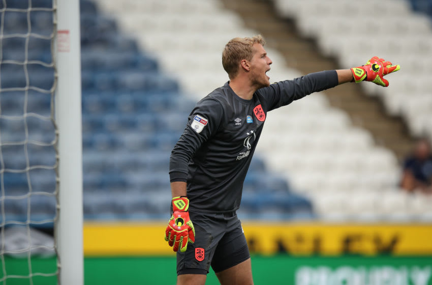 HUDDERSFIELD, ENGLAND - JULY 17: Jonas Lossl of Huddersfield Town during the Sky Bet Championship match between Huddersfield Town and West Bromwich Albion at John Smith's Stadium on July 17, 2020 in Huddersfield, England. Football Stadiums around Europe remain empty due to the Coronavirus Pandemic as Government social distancing laws prohibit fans inside venues resulting in all fixtures being played behind closed doors. (Photo by Robbie Jay Barratt - AMA/Getty Images)