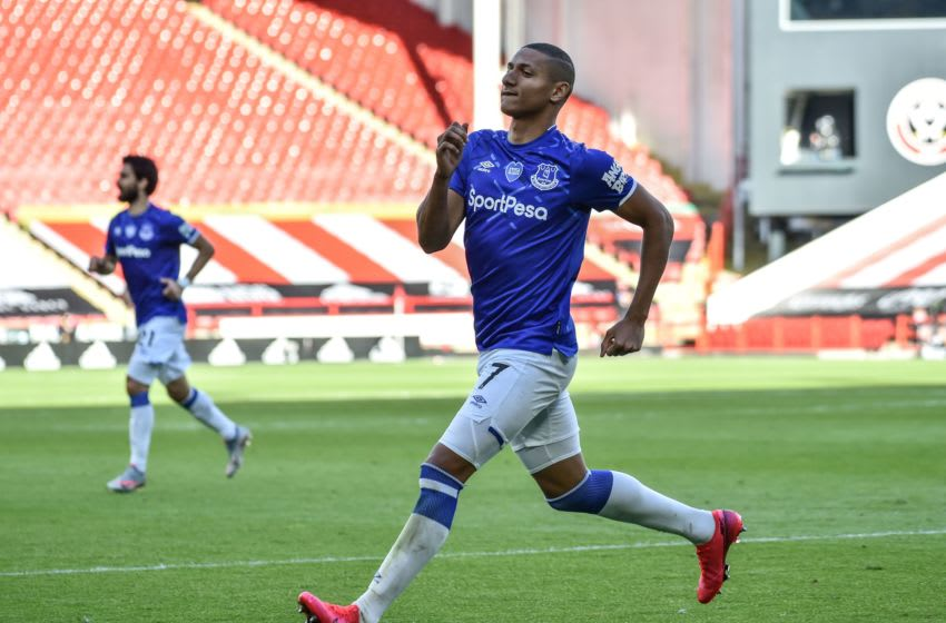 Everton's Brazilian striker Richarlison celebrates after scoring the opening goal during the English Premier League football match between Sheffield United and Everton at Bramall Lane stadium in Sheffield, northern England, on July 20, 2020. (Photo by Rui Vieira / POOL / AFP) / RESTRICTED TO EDITORIAL USE. No use with unauthorized audio, video, data, fixture lists, club/league logos or 'live' services. Online in-match use limited to 120 images. An additional 40 images may be used in extra time. No video emulation. Social media in-match use limited to 120 images. An additional 40 images may be used in extra time. No use in betting publications, games or single club/league/player publications. / (Photo by RUI VIEIRA/POOL/AFP via Getty Images)