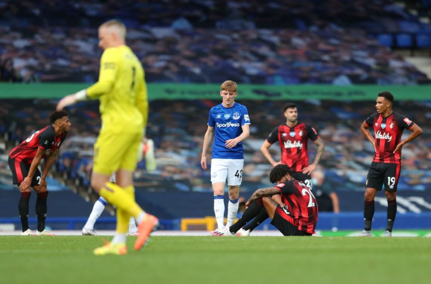 Bournemouth's players react at the end of the English Premier League football match between Everton and Bournemouth at Goodison Park in Liverpool, north west England on July 26, 2020. (Photo by Catherine Ivill / POOL / AFP) / RESTRICTED TO EDITORIAL USE. No use with unauthorized audio, video, data, fixture lists, club/league logos or 'live' services. Online in-match use limited to 120 images. An additional 40 images may be used in extra time. No video emulation. Social media in-match use limited to 120 images. An additional 40 images may be used in extra time. No use in betting publications, games or single club/league/player publications. / (Photo by CATHERINE IVILL/POOL/AFP via Getty Images)