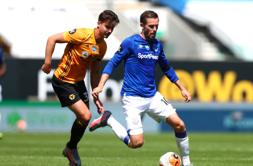 WOLVERHAMPTON, ENGLAND - JULY 12: Gylifi Sigurdsson of Everton and Leander Dendoncker of Wolverhampton Wanderers in action during the Premier League match between Wolverhampton Wanderers and Everton FC at Molineux on July 12, 2020 in Wolverhampton, England. Football Stadiums around Europe remain empty due to the Coronavirus Pandemic as Government social distancing laws prohibit fans inside venues resulting in all fixtures being played behind closed doors. (Photo by Chloe Knott - Danehouse/Getty Images)