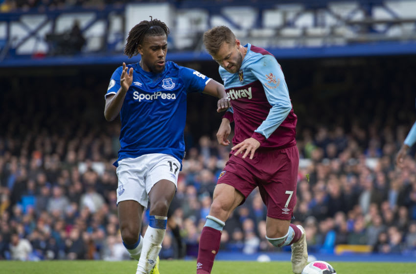 LIVERPOOL, ENGLAND - OCTOBER 19: Andriy Yarmolenko of West Ham United and Alex Iwobi of Everton in action during the Premier League match between Everton FC and West Ham United at Goodison Park on October 19, 2019 in Liverpool, United Kingdom. (Photo by Visionhaus)