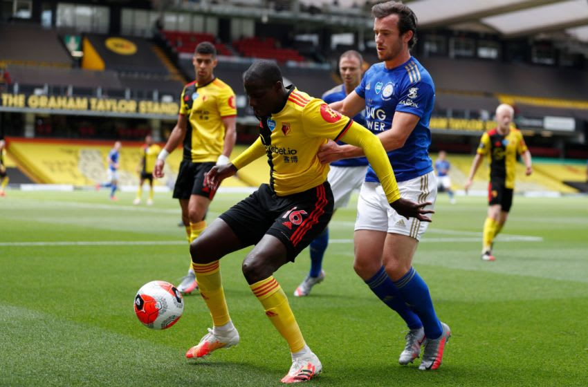 Watford's French midfielder Abdoulaye Doucoure (L) vies with Leicester City's English defender Ben Chilwell during the English Premier League football match between Watford and Leicester City at Vicarage Road Stadium in Watford, north of London on June 20, 2020. (Photo by Alastair Grant / POOL / AFP) / RESTRICTED TO EDITORIAL USE. No use with unauthorized audio, video, data, fixture lists, club/league logos or 'live' services. Online in-match use limited to 120 images. An additional 40 images may be used in extra time. No video emulation. Social media in-match use limited to 120 images. An additional 40 images may be used in extra time. No use in betting publications, games or single club/league/player publications. / (Photo by ALASTAIR GRANT/POOL/AFP via Getty Images)