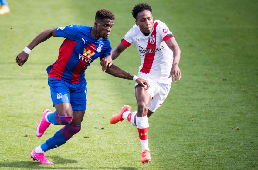 LONDON, ENGLAND - SEPTEMBER 12: Wilfried Zaha of Crystal Palace and Kyle Walker-Peters of Southampton in action during the Premier League match between Crystal Palace and Southampton at Selhurst Park on September 12, 2020 in London, United Kingdom. (Photo by Sebastian Frej/MB Media/Getty Images)