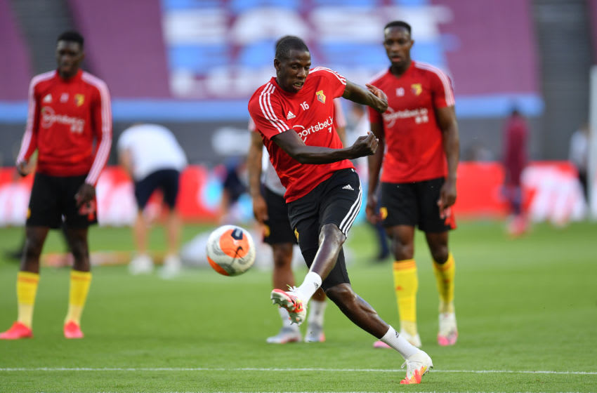 LONDON, ENGLAND - JULY 17: Abdoulaye Doucoure of Watford warms up prior to the Premier League match between West Ham United and Watford FC at London Stadium on July 17, 2020 in London, England. Football Stadiums around Europe remain empty due to the Coronavirus Pandemic as Government social distancing laws prohibit fans inside venues resulting in all fixtures being played behind closed doors. (Photo by Justin Setterfield/Getty Images)