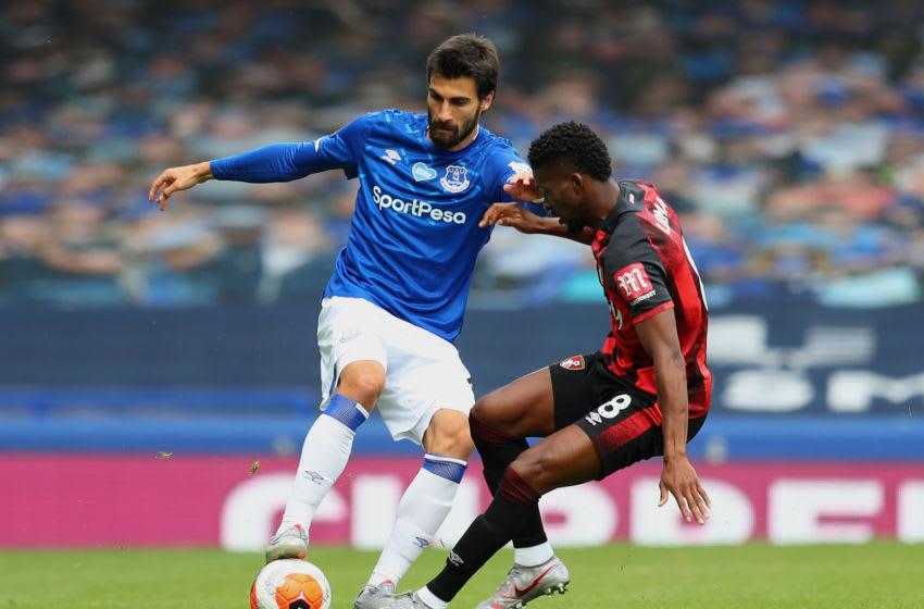 LIVERPOOL, ENGLAND - JULY 26: Andre Gomes of Everton battles for possession with Jefferson Lerma of AFC Bournemouth during the Premier League match between Everton FC and AFC Bournemouth at Goodison Park on July 26, 2020 in Liverpool, England. Football Stadiums around Europe remain empty due to the Coronavirus Pandemic as Government social distancing laws prohibit fans inside venues resulting in all fixtures being played behind closed doors. (Photo by Catherine Ivill/Getty Images)