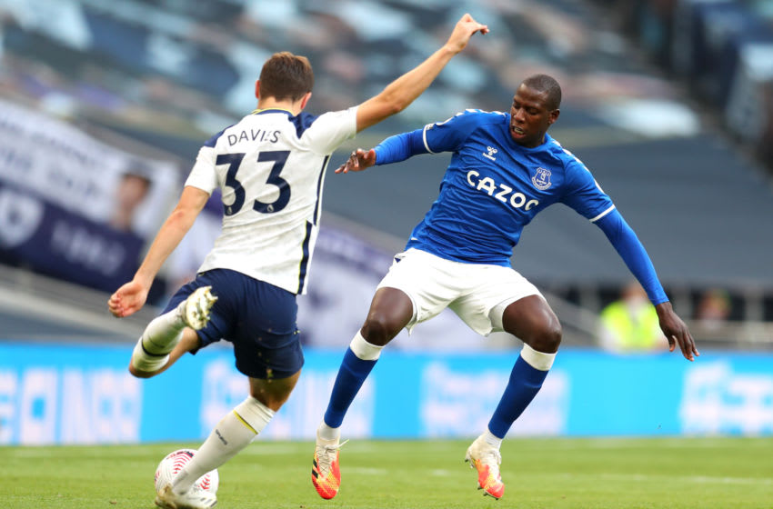 LONDON, ENGLAND - SEPTEMBER 13: Ben Davies of Tottenham Hotspur is challenged by Abdoulaye Doucoure of Everton during the Premier League match between Tottenham Hotspur and Everton at Tottenham Hotspur Stadium on September 13, 2020 in London, England. (Photo by Catherine Ivill/Getty Images)