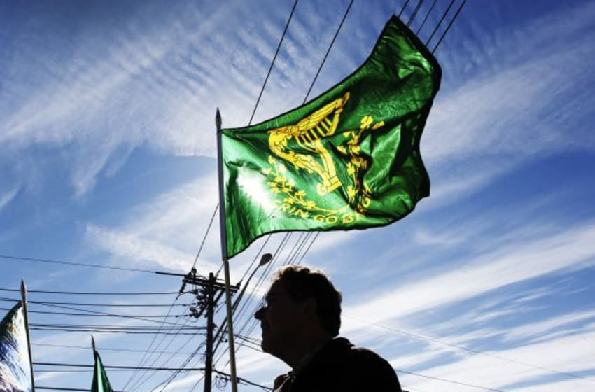 PORTLAND, ME - MARCH 13: A St. Patrick's Day parade participant carries an Irish flag stating Erin Go Bragh along Commercial Street Sunday, March 13, 2016. (Photo by Jill Brady/Portland Press Herald via Getty Images)