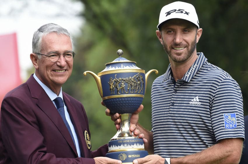 The CEO of the Salinas Group and organizer of the WGC-Mexico Ricardo Salinas (L) poses with US golfer Dustin Johnson and the trophy after he won the World Golf Championship at Chapultepec's Golf Club in Mexico City on February 24, 2019. (Photo by ALFREDO ESTRELLA / AFP) (Photo credit should read ALFREDO ESTRELLA/AFP via Getty Images)