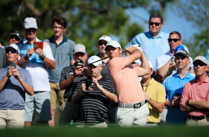 PONTE VEDRA BEACH, FLORIDA - MARCH 11: Rory McIlory of Northern Ireland plays a tee shot as fans look on during a practice round prior to The PLAYERS Championship on The Stadium Course at TPC Sawgrass on March 11, 2020 in Ponte Vedra Beach, Florida. (Photo by Cliff Hawkins/Getty Images)