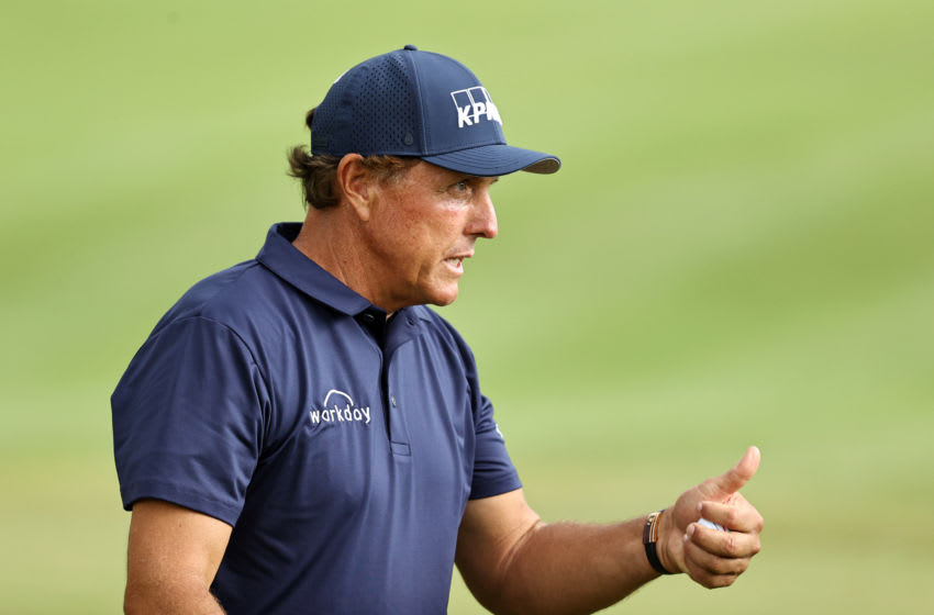 CROMWELL, CONNECTICUT - JUNE 26: Phil Mickelson of the United States reacts after making a putt for birdie on the 18th green during the second round of the Travelers Championship at TPC River Highlands on June 26, 2020 in Cromwell, Connecticut. (Photo by Elsa/Getty Images)