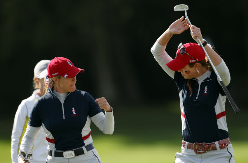 Paula Creamer (R) and Cristie Kerr (L) of the U.S bump hips to celebrate on the 17th green during the foursomes match against Europe's Catriona Matthew and Azahara Munoz during Day Two of The Solheim Cup at Killeen Castle in Dunsany near Dublin, Ireland on September 24, 2011. AFP PHOTO / ADRIAN DENNIS (Photo credit should read ADRIAN DENNIS/AFP via Getty Images)