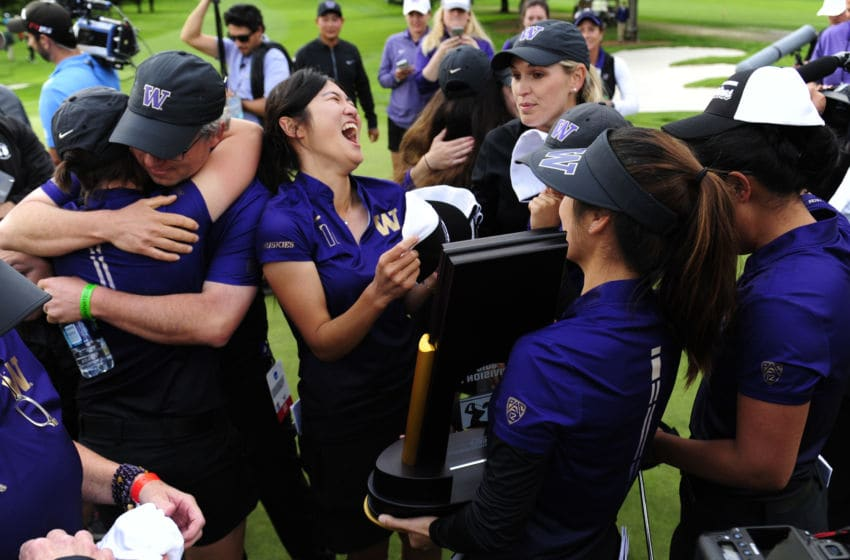 PORTLAND, OR - MAY 25: Members of the Washington Huskies golf team celebrate with the trophy after winning the 2016 NCAA Division I Women's Golf Championship against Stanford at Eugene Country Club on May 25, 2016 in Eugene, Oregon. (Photo by Steve Dykes/Getty Images)