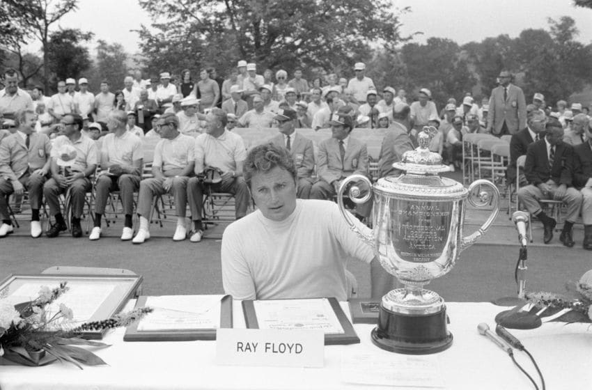 1969: Ray Floyd sits on a table next to the Annual Championship of the Professional Golfers Association of America, Rodman Wanamaker Trophy as he wins the 1969 PGA championship. (Photo by Martin Mills/Getty Images)