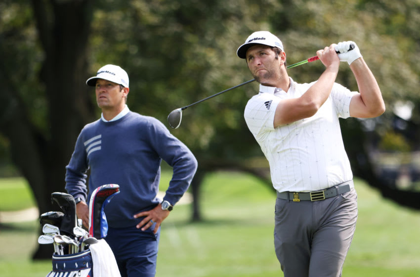 MAMARONECK, NEW YORK - SEPTEMBER 15: Jon Rahm (R) of Spain plays a tee shot as caddie Adam Hayes (L) looks on during a practice round prior to the 120th U.S. Open Championship on September 15, 2020 at Winged Foot Golf Club in Mamaroneck, New York. (Photo by Jamie Squire/Getty Images)