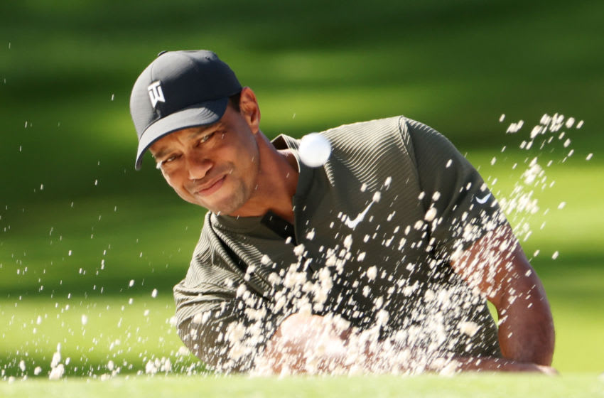 AUGUSTA, GEORGIA - NOVEMBER 12: Tiger Woods of the United States plays a shot from the bunker on the second hole during the first round of the Masters at Augusta National Golf Club on November 12, 2020 in Augusta, Georgia. (Photo by Jamie Squire/Getty Images)