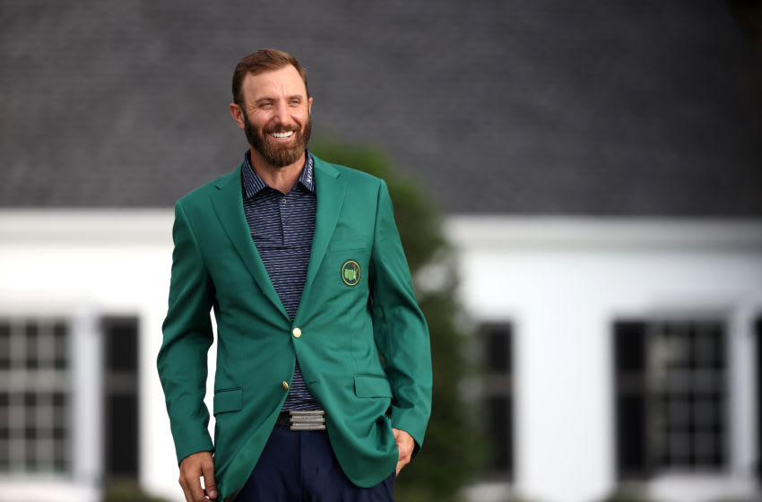 AUGUSTA, GEORGIA - NOVEMBER 15: Dustin Johnson of the United States reacts during the Green Jacket Ceremony after winning the Masters during the final round of the Masters at Augusta National Golf Club on November 15, 2020 in Augusta, Georgia. (Photo by Rob Carr/Getty Images)