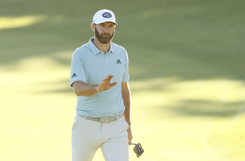 PACIFIC PALISADES, CALIFORNIA - FEBRUARY 19: Dustin Johnson of the United States waves as he walks onto the 18th green during the second round of The Genesis Invitational at Riviera Country Club on February 19, 2021 in Pacific Palisades, California. (Photo by Steph Chambers/Getty Images)