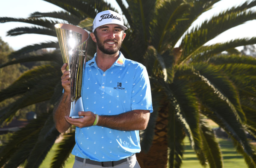 PACIFIC PALISADES, CALIFORNIA - FEBRUARY 21: Max Homa of the United States poses with the trophy after defeating Tony Finau of the United States (not pictured) in a playoff to win The Genesis Invitational at Riviera Country Club on February 21, 2021 in Pacific Palisades, California. (Photo by Harry How/Getty Images)