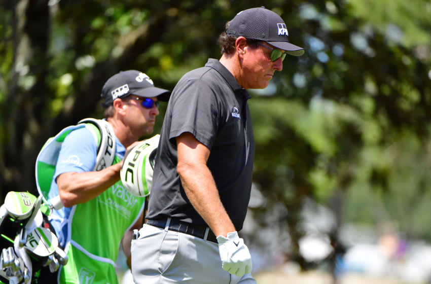 PALM HARBOR, FLORIDA - APRIL 29: Phil Mickelson of the United States walks with his caddie Tim Mickelson on the sixth hole during the first round of the Valspar Championship on the Copperhead Course at Innisbrook Resort on April 29, 2021 in Palm Harbor, Florida. (Photo by Julio Aguilar/Getty Images)