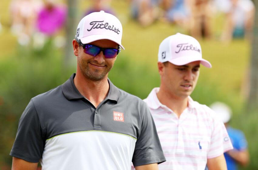 PONTE VEDRA BEACH, FL - MAY 15: Adam Scott of Australia (L) and Justin Thomas of the United States walk on the 18th hole during the final round of THE PLAYERS Championship at the Stadium course at TPC Sawgrass on May 15, 2016 in Ponte Vedra Beach, Florida. (Photo by Scott Halleran/Getty Images)