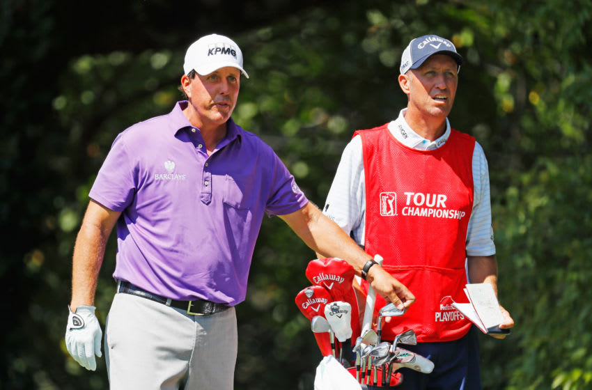 ATLANTA, GA - SEPTEMBER 22: Phil Mickelson waits to hit his tee shot on the second hole alongside his caddie Jim Mackay during the first round of the TOUR Championship By Coca-Cola at East Lake Golf Club on September 22, 2016 in Atlanta, Georgia. (Photo by Kevin C. Cox/Getty Images)