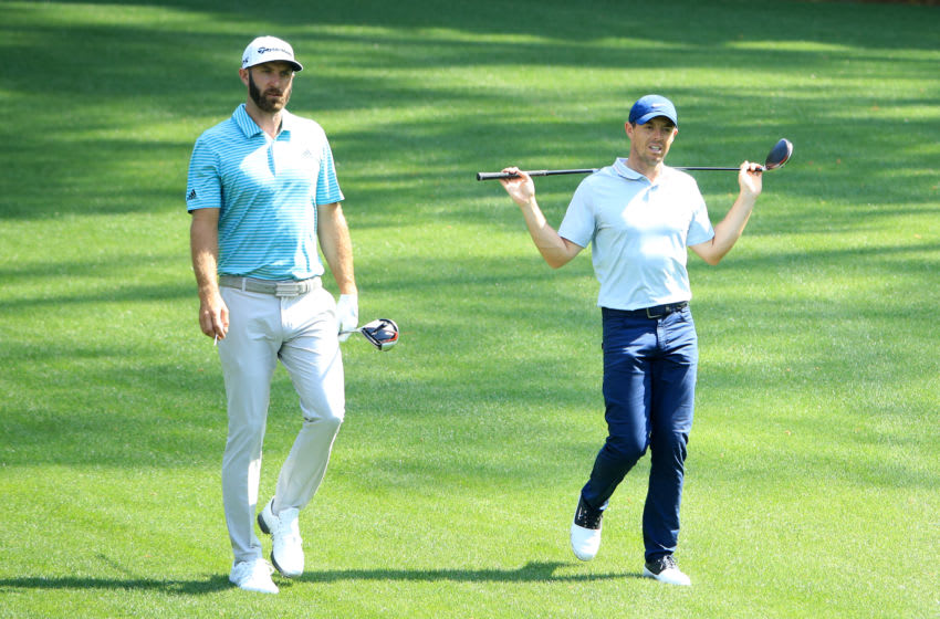 AUGUSTA, GEORGIA - APRIL 08: Rory McIlroy of Northern Ireland and Dustin Johnson of the United States walk on the second hole during a practice round prior to The Masters at Augusta National Golf Club on April 08, 2019 in Augusta, Georgia. (Photo by Andrew Redington/Getty Images)