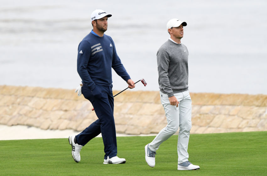 PEBBLE BEACH, CALIFORNIA - JUNE 14: Jon Rahm of Spain (L) and Rory McIlroy of Northern Ireland walk up the 18th hole during the second round of the 2019 U.S. Open at Pebble Beach Golf Links on June 14, 2019 in Pebble Beach, California. (Photo by Harry How/Getty Images)