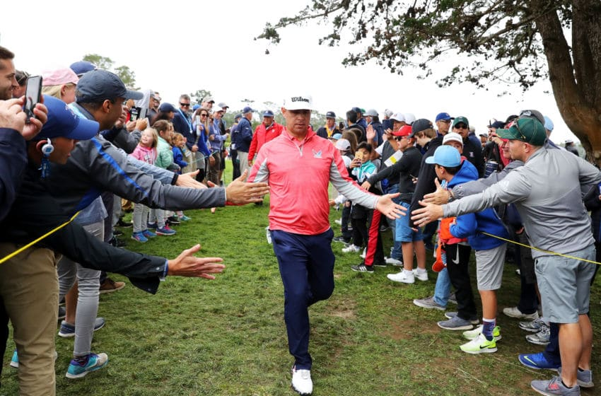 PEBBLE BEACH, CALIFORNIA - JUNE 16: Gary Woodland of the United States greets fans as he walks off the 14th hole during the final round of the 2019 U.S. Open at Pebble Beach Golf Links on June 16, 2019 in Pebble Beach, California. (Photo by Warren Little/Getty Images)