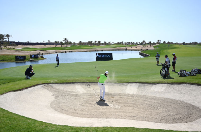 UNSPECIFIED, SAUDI ARABIA - JANUARY 30: Haotong Li of China plays his third shot on the 9th hole during Day 1 of the Saudi International at Royal Greens Golf and Country Club on January 30, 2020 in King Abdullah Economic City, Saudi Arabia. (Photo by Ross Kinnaird/Getty Images)