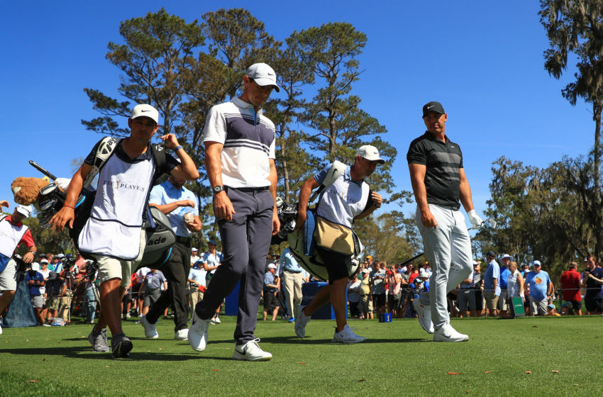 PONTE VEDRA BEACH, FLORIDA - MARCH 12: Rory McIlroy of Northern Ireland walks off the sixth tee with Brooks Koepka of the United States during the first round of The PLAYERS Championship on The Stadium Course at TPC Sawgrass on March 12, 2020 in Ponte Vedra Beach, Florida. (Photo by Mike Ehrmann/Getty Images)