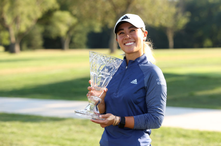 SYLVANIA, OHIO - AUGUST 09: Danielle Kang celebrates with the trophy after winning the Marathon LPGA Classic during the final round at Highland Meadows Golf Club on August 09, 2020 in Sylvania, Ohio. (Photo by Gregory Shamus/Getty Images)
