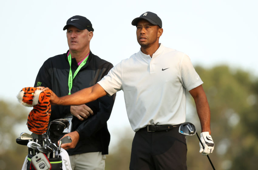 MAMARONECK, NEW YORK - SEPTEMBER 16: Tiger Woods (R) of the United States pulls a club from his bag next to caddie Joe LaCava (L) during a practice round prior to the 120th U.S. Open Championship on September 16, 2020 at Winged Foot Golf Club in Mamaroneck, New York. (Photo by Gregory Shamus/Getty Images)
